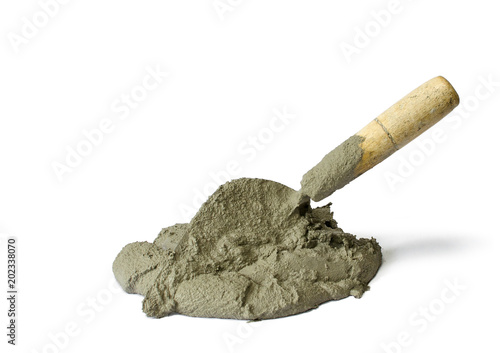 Photo  Cement or mortar with the trowel, Cement mix pile with the trowel isolated on white background with Clipping Path