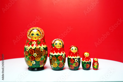 Matryoshka traditional Russian wooden dolls;Russian souvenir Matrioshka ;Nesting dolls on red background bring in lucky and wealthy Canvas Print