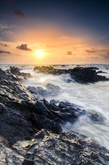 Plakat Amazing nature seascape background with beautiful color of sunrise, Soft focus due to long exposure.