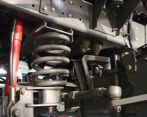 Fotografía  Watering machine. Gray suspension spring with shock absorber.