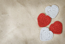 Knitted Hearts On Wrinkled Coa...