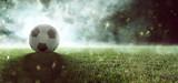 Fototapeta sport - Fußball liegt auf Stadionrasen im Rauch