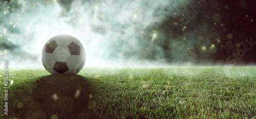 mata magnetyczna Fußball liegt auf Stadionrasen im Rauch