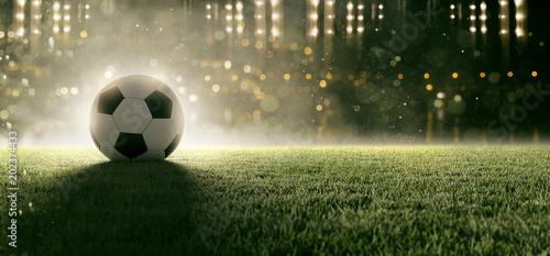 fototapeta na szkło Fußball liegt auf Stadionrasen im Rauch