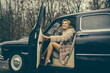Travel and business trip or hitch hiking. sexy woman in fur coat. Escort and security guard for luxury woman. Call girl in vintage car. Retro collection car and auto repair by driver