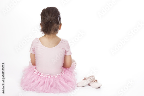 fd3906943 Lonely girl in ballet dress   Back view of little girl in pink dress ...