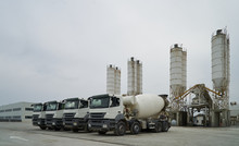 Concrete Factory With Silos And Trucks. Concrete Mixing Silo, Site Construction Facilities. Industry Manufacturing Concept