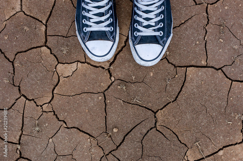 Looking down at my feet on cracked land Canvas Print