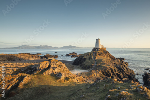 Foto op Aluminium Kust Victorian Lighthouse of Llanddwyn Island in Warm Sunset Light