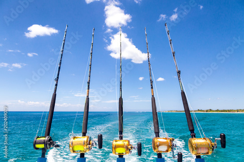 Papiers peints Peche Row of Deep Sea Fishing Rods on Boat
