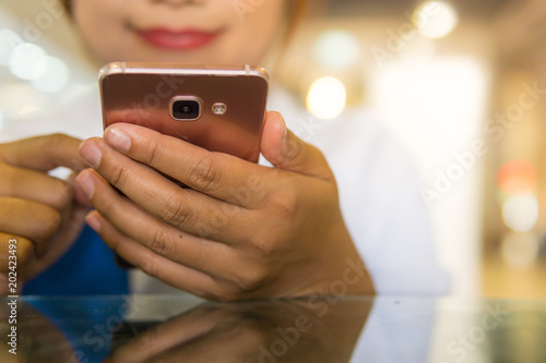 Fototapety, obrazy: Happy moment with smartphone, Asian women teen play mobile phone reading screen and at the coffee shop or cafe