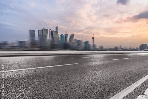 Fototapeta cityscape and skyline of shanghai from empty asphalt road. obraz na płótnie