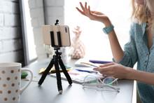 Female Blogger Recording Video...