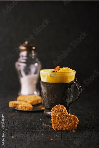 Turmeric latte or golden milk with oats cookies
