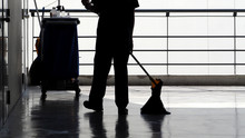 Silhouette Of Cleaning Service People Sweeping Floor