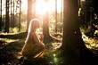 canvas print picture - Junge Frau betet im Wald zum Sonnenuntergang