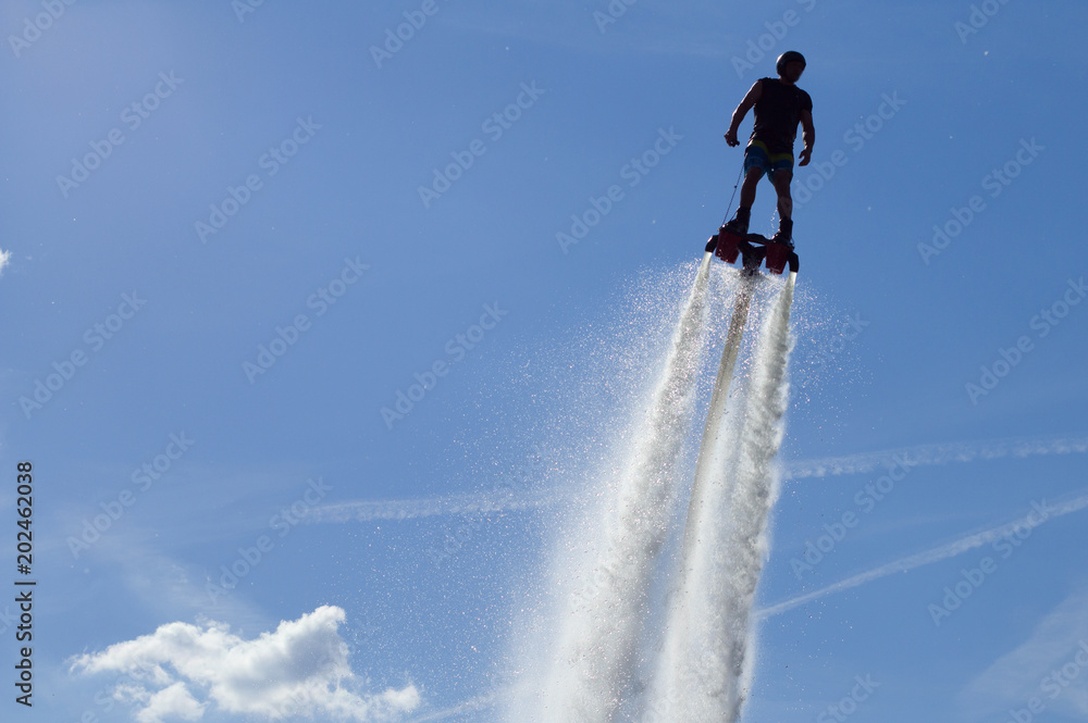 Fototapety, obrazy: Flyboarding session in the aquamarine waters..