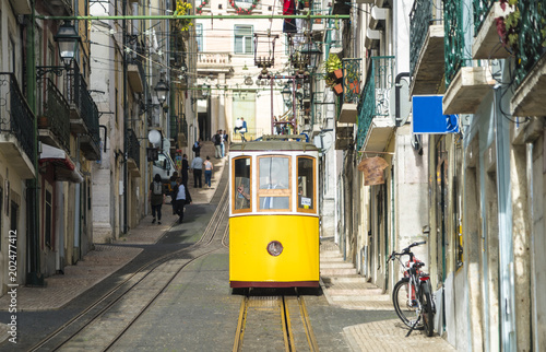 Portugal, Lisbon, Bairro Alto, Elevador da Bica, yellow cable railways