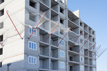 Residential Building Under Construction With Safety Net, Protective Grid Prevent Object Falling From Height