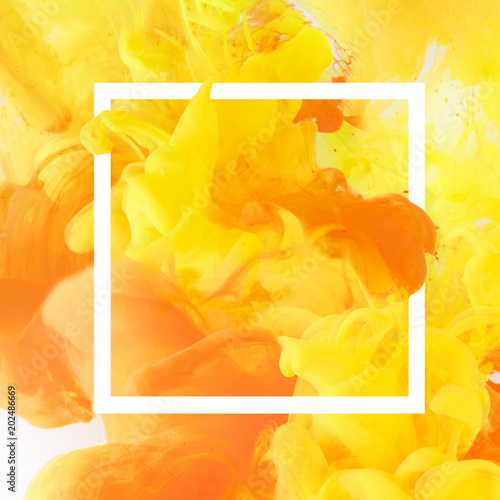 creative design with flowing yellow and orange paint in white square frame