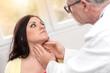 Doctor checking thyroid, light effect