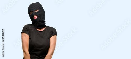 Burglar terrorist woman wearing balaclava ski mask thinking and looking up expre Wallpaper Mural