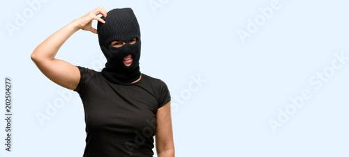 Photo Burglar terrorist woman wearing balaclava ski mask doubt expression, confuse and