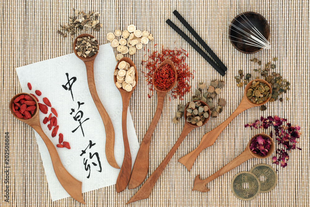Fototapeta Traditional chinese herbs, acupuncture needles, moxa sticks used moxibustion therapy, feng shui coins and calligraphy script on rice paper on bamboo. Translation reads as chinese herbs. Top view.