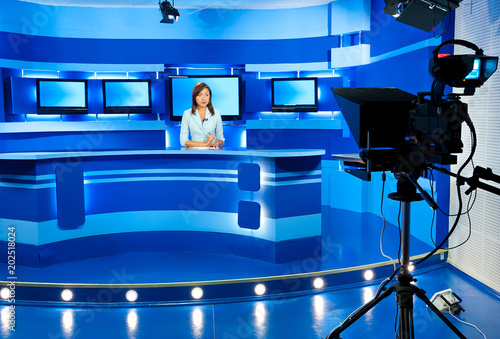 Leinwand Poster television newscaster at blue TV studio