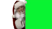 Santa Hiding Behind A Green Sc...
