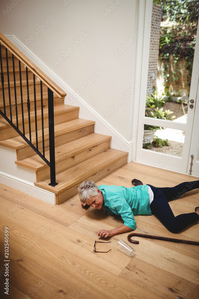 Fototapety, obrazy: Senior woman fallen down from stairs