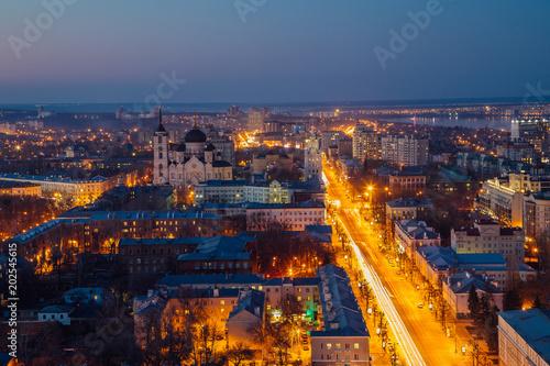Fototapeta Night Voronezh downtown. Aerial view from skyscraper roof height to Revolution prospect - central street of Voronezh obraz na płótnie