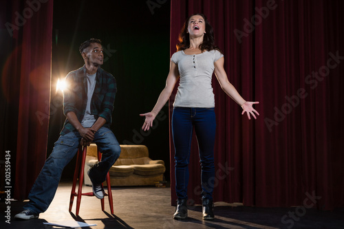 Artists rehearsing on stage Canvas Print