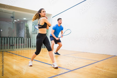 Fotografia, Obraz  Couple play some squash together