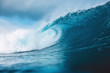 canvas print picture - Ocean blue wave in ocean. Breaking wave for surfing in Bali