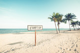 Landscape of coconut palm tree on tropical beach in summer. beach sign for surfing area. Vintage effect color filter. - 202590203