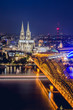 Cologne Dome and Hohenzollern Bridge at nighttime
