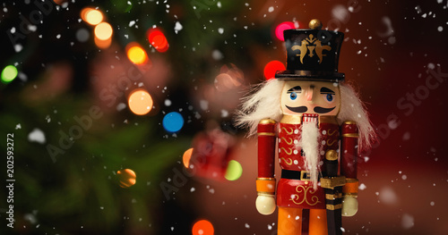 Foto auf Gartenposter Historische denkmal Snow falling against close-up of nutcracker toy solider christmas decoration