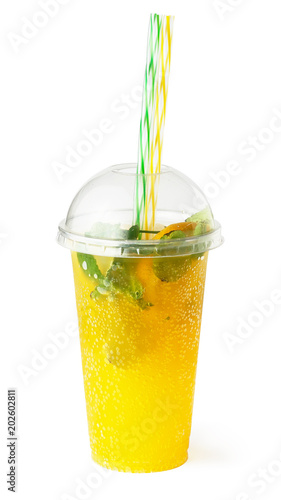 Orange lemonade in plastic glass, cooling fruit drink