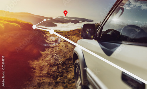 Off-road Car On Mountains And Clouds Background With Augmented Reality. Road Adventure Vacation Concept