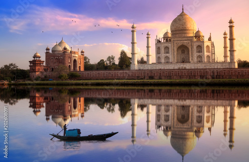 Taj Mahal Agra at sunset with wooden boat on river Yamuna. Wallpaper Mural