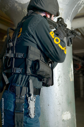 Armed police officer doing tactical training - Buy this stock photo