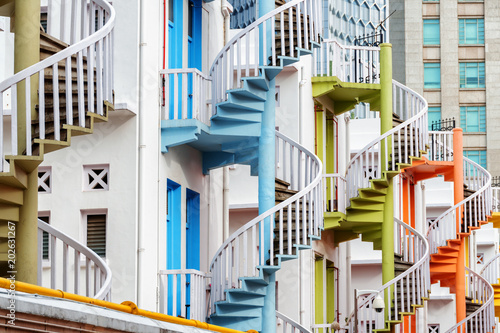 Tuinposter Singapore Colorful exterior spiral staircases in Singapore
