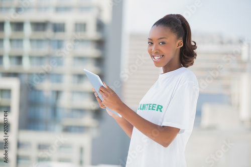 Fotografia, Obraz  Sweet smiling girl using tablet pc