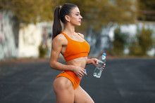 Young Fit Woman Drinking Water, Outdoors. Athletic Female Quenches Thirst