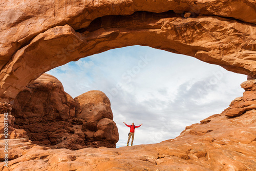 Canvas Print Travel in Arches National Park, man hiker with backpack in North Window, Utah, U