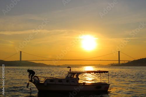 Foto auf AluDibond Pier Bosphorus Bridge at Sunset