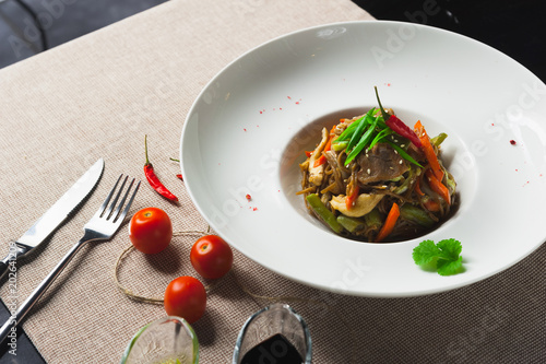 Keuken foto achterwand Klaar gerecht Healthy pasta with meat and vegetables on a white plate with with herbs and pepper