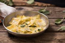 Italian Cuisine: Ravioli Pasta With Parmesan Cheese And Sage