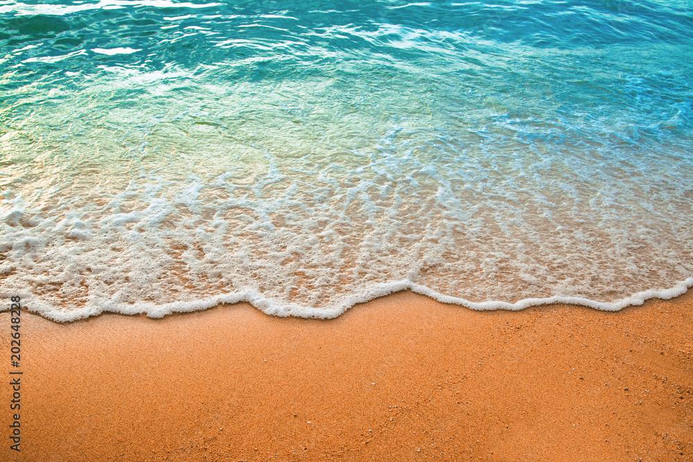Fototapety, obrazy: Wave of blue ocean on sandy beach. Background.